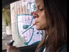 Raphaela 4 - Leathergirl Smoking in a Car