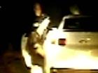 Dashboard cam shows police slam woman against car